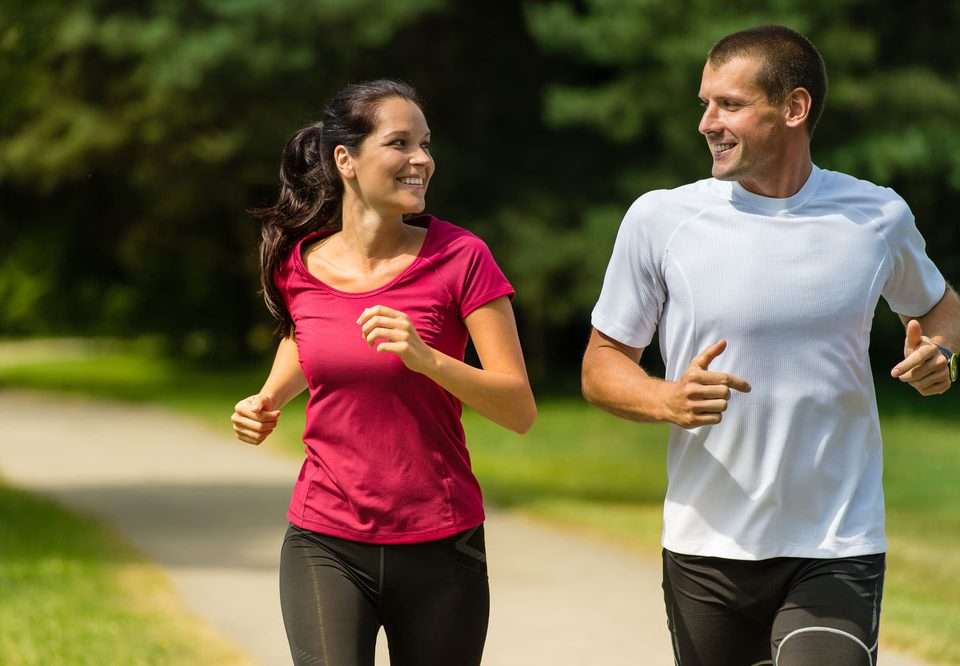 couple running smiling at each other