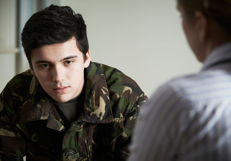 soldier with ptsd talking to doctor